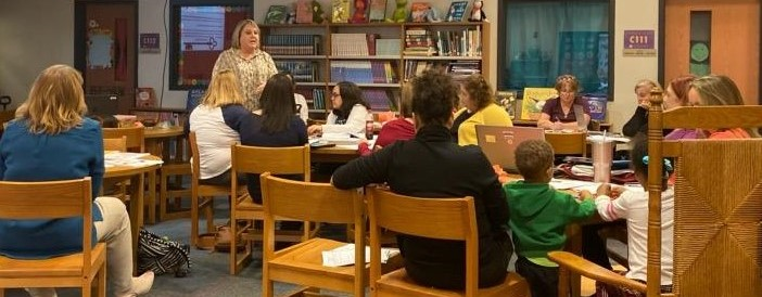 Faculty and parents join together to listen to a speacker at Bowling Green Elementary Library.