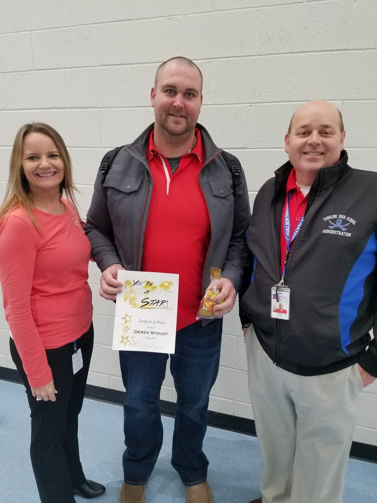 Mrs. White, Transition Coordinator and Mr. Hancock, Assistant Principal stand with You're a Star award winner, Derek Stoudt.